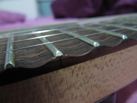 Scalloped fingerboard details