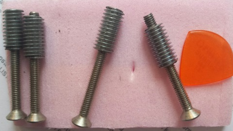 Allen head countersunk screws and steel threaded inserts for the neck